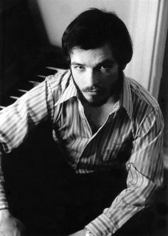 Bruce seated at the piano